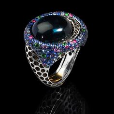 Mousson Atelier, collection New Age - Honeycombs, Black gold 750, London topaz 26,13 ct., Multicolored sapphires