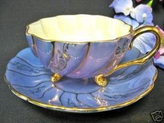CHINA TEACUP FOOTED 3 LEGGED TEA CUP AND SAUCER PURPLE (03/13/2007)