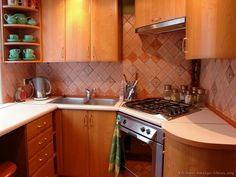 Modern Medium Wood Kitchen Cabinets #35 (Kitchen-Design-Ideas.org)