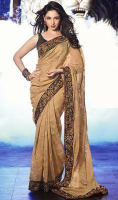 Tamannaah Beige Jacquard Net Saree Price: Usa Dollar $98, British UK Pound £58, Euro73, Canada CA$106 , Indian Rs5292.