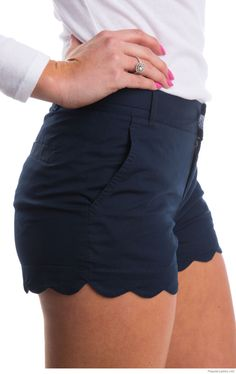 A white blouse with navy shorts