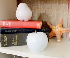 (been there, done that) - Spray Paint fake plastic fruit with white paint to make it look like ceramic