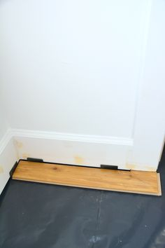 How To Install Laminate Flooring Over Concrete Laminate Flooring Basement, Installing Laminate Flooring, Vinyl Plank Flooring, Entryway Tables, Concrete, Room, Furniture, Home Decor, Bedroom