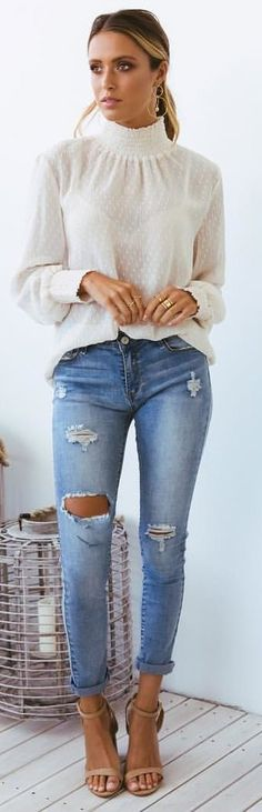 #spring #outfits woman standing wearing white long-sleeved shirt and distressed blue jeans outfit. Pic by @sundaysthelabel