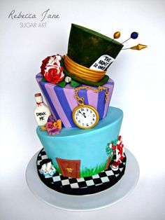 Alice in Wonderland topsy turvey cake - For all your cake decorating supplies, please visit craftcompany.co.uk