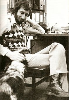 Pete Townshend, happy with a dog