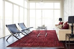 red rug, modern living room, contemporary living room, antique rug, persian rug