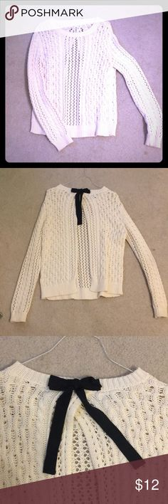 Open back sweater Gently used cream sweater with open back and bow detailing. Sweaters