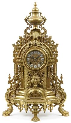 A FRENCH ROCOCO STYLE GILT METAL MANTEL CLOCK.