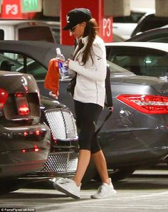 Off-duty: Victoria, wore cropped leggings and boxfresh trainers for the outing