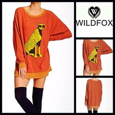 "WILDFOX Tunic Dress Jungle Cat WILDFOX  Tunic Sweater Road Trip Dress Jungle Cat   NEW WITH TAGS RETAIL: $138  * A relaxed fit. * Incredibly soft & comfortable  * Graphic detail on front; A texture that is purposely subtly distressed/'washed'. * About 32.5"" long. * A crew neck, contrast trim, & long sleeves   Fabric: Rayon, Polyester, & 6% Spandex; Made in the USA Color:Burnt Orange Item:WF11200  No Trades/PAYPAL ✅ Offers Considered*✅ ✅ Bundle Discounts  ✅ *Please use the blue 'offer' button…"