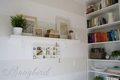 cute tiny room! i love the little type box shelf with little trinkets and differently lined backings.