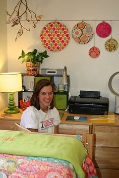 Dorm room - like how she snuggled dresser up to desk and got more counter space.  String for hanging art and photos good idea