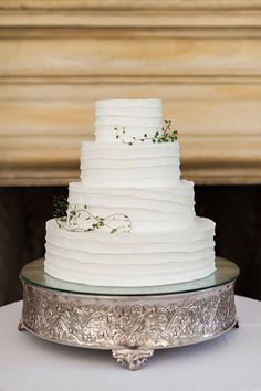 The wedding cake was simple and elegant with just a touch of greenery.