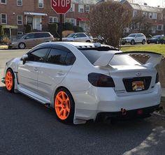 Subaru WRX STi.. Neon Orange Wheels be popping!!