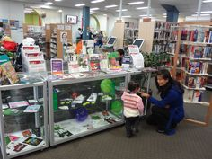Marrickville Library patrons checking out the Drug Action Week display