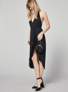 Just add feathers.  This is a midi length, wrap dress with a halter neck and feather edged skirt.http://bit.ly/2hgx9I4