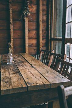 rustic wood table + wood paneling