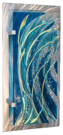 Master Artisan Frank Thompson has 35 years experience in creating one of a kind stained glass doors and windows. He presently creates award winning contemporary glass wall art and his show schedule is posted and updated as juried invitations are received.