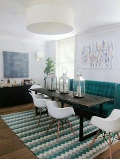 High back couch at dining table to create cozy booth effect
