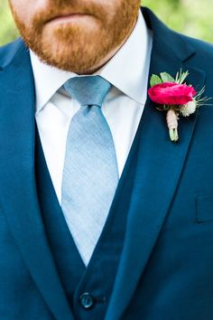 Berry-colored boutonniere Floral: Sweet Annie Floral Design Photo: Sarah Jayne Photography