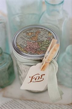 Re-purposed canning jar. Give as a gift with cute handmade tag .  I love the map on top.