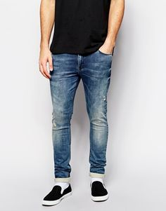 8096ebd5cb298 Jeans by ASOS Stretch denim Distressed detailing Concealed button fly Five  pocket styling Super skinny fit - cut closest to the body Machine wash  Cotton