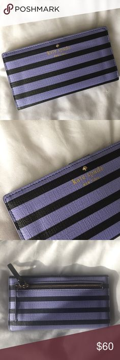 NWOT Kate Spade Wallet Adorable Kate Spade Wallet with light purple and black stripes. Brand new without tags, I received it as a gift and never ended up using it. So cute and the perfect size to fit all your cards and cash! kate spade Bags Wallets