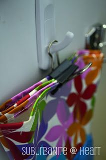 Use binder clips to hang gloves from pegboard hooks