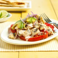 There's no alcohol in the margarita drink mix marinade, but the flavor is all there. Rich avocado and juicy tomatoes add their light fresh flavors to this grilled chicken salad recipe.