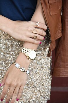 Gal Meets Glam. Sparkle skirt, navy shirt, and pretty rings