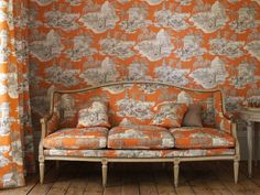 orange and grey toile upholstery on multiple surfaces