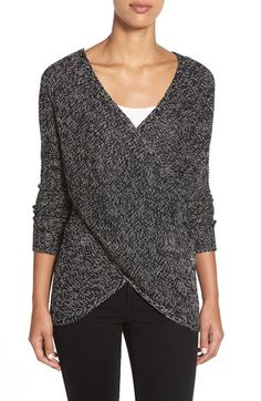 Looks like the sweater is slouchy and comfy but also has a flattering shape