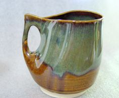 Pottery Cup with Squashed Handle in Amber and Sage Green