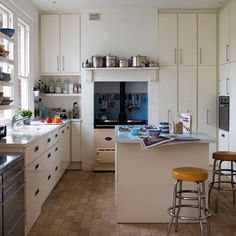 Shelf above the stove, hooks behind the stove and the blue black splash - great kitchen organization and decor