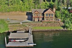 Stunning waterfront home on Lake Coeur d'Alene just completed and ready to be enjoyed! Easy stroll to the water's edge with covered slip with boat lift and jet ski lifts. Large deck with built in BBQ for entertaining, gorgeous open great room design, and open loft area to relax. 4 Bedrooms, 2.5 Bathrooms, beautiful master with walk in tile shower and soaker tub. This absolutely gorgeous home is located in a gated community with endless lake views.