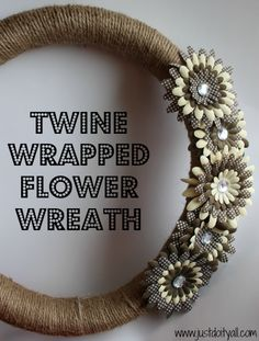 twine wrapped with flowers (updated link) materials: plumbing tubular pipe insulation to make the wreath form, twine/rope, paper flowers from the scrapbooking section