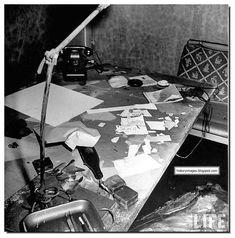 Burned and scattered papers on desk inside Adolf Hitler's command bunker.
