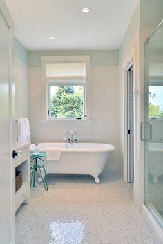 beautiful bathroom with clawfoot tub + marble floor
