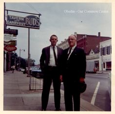 "ID#:0061 Date:1950-1960s. Glenn Molyneaux and his son Glenn Molyneaux, Jr., ""Jim"" on the sidewalk outside Watson's Hardware. Participant:Barbara Molyneaux. Additional Sources Used For History:O.H.I.O. Resource Center: Fred Maddock files., Historic Preservation Commission, Survey 1998, City Directories;Internet correspondence from Jim Molyneaux, 01/16/01. Interview with Jim and Barbara Molyneaux, 6/00. Interview with Glenn Molyneaux, 6/00; Interview with Pat Stetson, 01/01 Jr, 1960s, The Outsiders, The Past, Interview, Sidewalk, Hardware, History, City"
