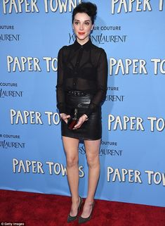 Dark side: The 32-year-old musician - real name Annie Clark - rocked a sheer black top tu...