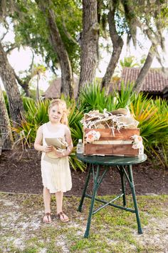 We're pretty sure with a #cutie like this, #weddingguests might want extra #programs. She's just too #darling! We love the #romantic #charm of this image + the #ceremony. ::Jessica + Tyler's romantic wedding in Sea Island, Georgia::  #seaisland #gaweddings #seaislandga #diy #weddingideas #ceremonyideas #diyceremony