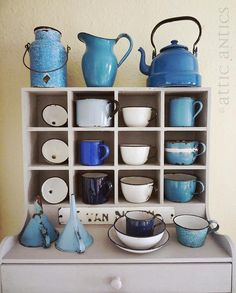 Love this cubbie cabinet –it's perfect to display my collection of enamel cups and funnels! (all currently for sale at Monticello Antique Marketplace in Portland, Oregon)