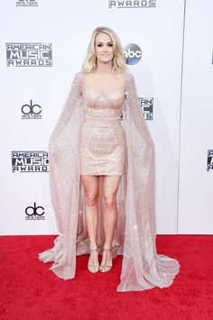 CARRIE UNDERWOOD In Elie Madi dress, Greymer shoes, and Kimberley McDonald jewelry