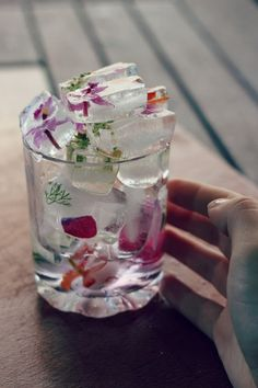 Flowers frozen into ice cubes. Cute!