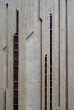 Fernando Menis cavernous concert hall in Poland uses crushed brickwork