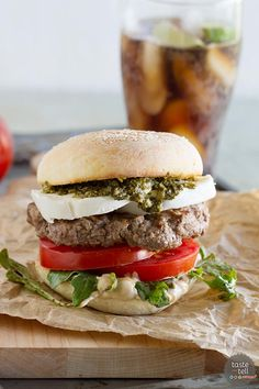 Summer in a burger, this Caprese Burger has all the flavors of a Caprese salad - mozzarella, tomatoes and basil. Plus a review of The Art of the Burger by Jens Fischer.:
