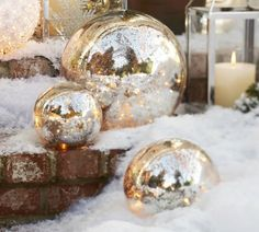 I think I could make these by purchasing globe-shaped light covers, spraying insides with Krylon Looking Glass paint, and inserting a string of clear-colored small lights,  WAY less expensive than Pottery Barn!