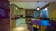 Lovely use of Aubergine Purple to create a real focal point in the kitchen