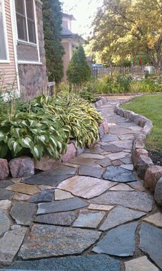 Rock Path. Hand chiseled field stone edge with flagstone. #LandscapingEdging